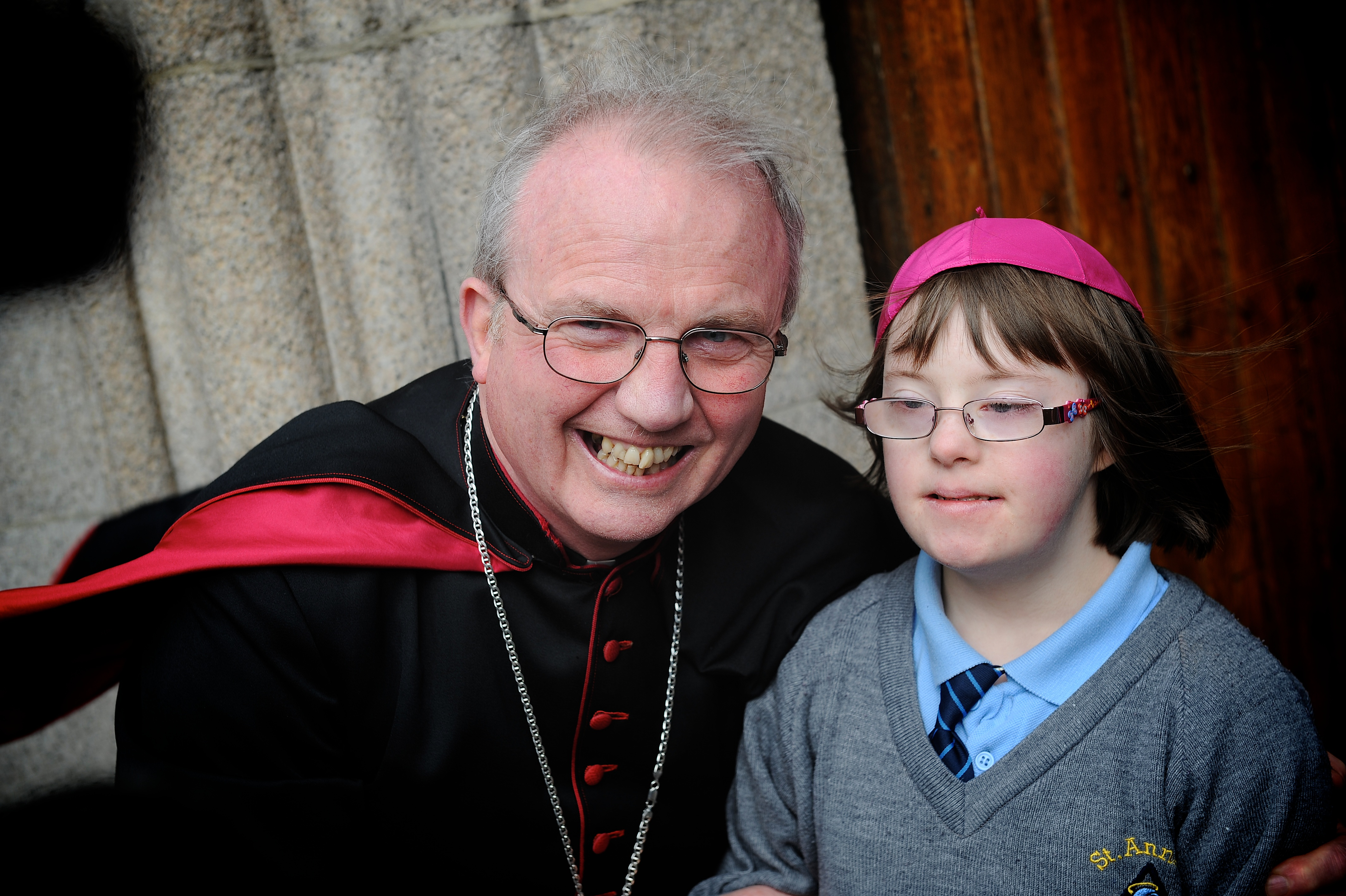 25 Feb 2014 Bishop Donal McKeown with St Anne's pupil Emma McDaid